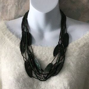 Artisan 8 strand green shell leaf bead necklace